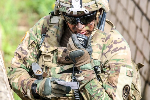 Staff Sgt. Mario Garza, an infantryman and squad leader with Ghost Troop, 2nd Squadron, 2nd Cavalry Regiment, calls for a medical evacuation during a live-fire exercise during Exercise Hunter, May 11, 2016, at General Silvestras Zukauskas Training Area in Pabrade, Lithuania. More than 1200 Soldiers from Canada, Germany, Latvia, Lithuania, Poland and United States participated in Exercise Hunter, which allowed commanders the opportunity to integrate allied troops into their units.