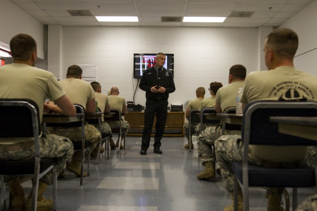 Capt. James Malloy a shift supervisor at the Charles Egeler Reception and Guidance Center instructs U.S. Army Reserve Soldiers assigned to the 303rd Military Police Company in Jackson, Michigan, May 15. The Soldiers were taught inmate control by corrections officer trainers at the local facility. The training is in place to augment their detainee operations in preparation for an upcoming deployment to Guantanamo Bay, Cuba. (U.S. Army photo by Sgt. Audrey Hayes)