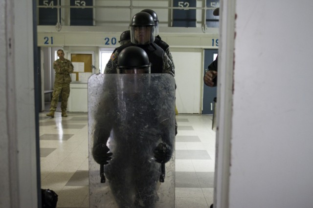 U.S. Army Reserve Soldiers assigned to the 303rd Military Police Company prepare to breach a prison cell during cell extraction training at the Charles Egeler Reception and Guidance Center in Jackson, Michigan, May 15. The corrections officer trainers at the local facility instructed the Soldiers on the proper extraction procedures. The training is in place to augment their detainee operations in preparation for an upcoming deployment to Guantanamo Bay, Cuba. (U.S. Army photo by Sgt. Audrey Hayes)
