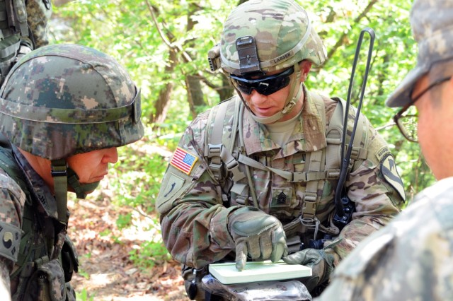 Command Sgt. Maj. Greg Larsesn (right), 1st Calvary Division, briefs the plan for an upcoming objective to a Republic of Korea army soldier during the Mangudai Challenge May 11, 2016 at Camp Casey, South Korea. Larsen and other leaders participated in the challenge from May 11-13.