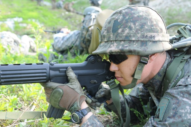 Master Sgt. Gook Min-Soo, Republic of Korean Army Non-Commissioned Officer Academy, pulls security during temporary stop enroute to an objective during the Mangudai Challenge May 12, 2016 at Camp Casey, South Korea. Gook and other RoK Army NCOs participated in the challege from May 11-13.
