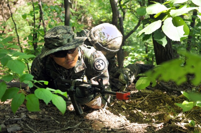 A Republic of Korea army soldier pulls security during a temporary stop enroute to an objective during the Mangudai Challenge May 11, 2016 at Camp Casey, South Korea. The Soldier and other leaders participated in the challenge from May 11-13.