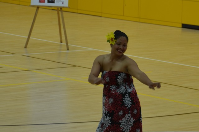 ANSBACH, Germany (May 18, 2016) -- Cristina Salvador, a volunteer from Hohenfels, performs a traditional Pacific Island dance. Cristina and her sister Karen have performed at other Asian-American Pacific Island Hertiage Month observances at USAG Ansbach and other garrisons. To celebrate May as Asian-American and Pacific Islander Heritage Month, U.S. Army Garrison Ansbach and 12th Combat Aviation Brigade held an observance at the Katterbach Fitness Center here Friday evening. The Equal Opportunity advisers of USAG Ansbach and 12th CAB hosted the event, inviting community members to watch -- and take part in -- traditional Pacific Island dances, to enjoy a variety of different foods representing a diverse and geographically widespread group of cultures, and to learn a few things about the heritage and history of several cultures who have played an integral part in the history of the U.S. and of the U.S. Army. (U.S. Army photo by Bryan Gatchell, USAG Ansbach Public Affairs)