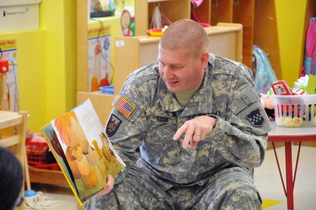Sgt. Russell Toof, a public affairs specialist assigned to the U.S. Army Reserve's 326th Mobile Public Affairs Detachment in Reading, Pennsylvania, reads to children at a preschool in Clementon, New Jersey May 12 as part of a military appreciation day at the school.