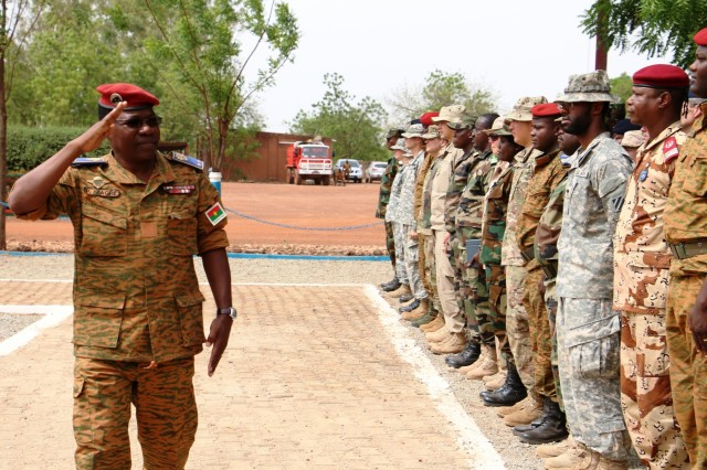 General Pingrenoma Zagre, Chief of Defense Staff for Burkina Faso Armed Forces, salutes multinational Western Accord 2016 participants during the exercise's Closing Day Ceremony May 13, 2016 at Camp Zagre, Ouagadougou, Burkina Faso. The two-week command post exercise, which began May 2, brought together 15 West African Nations, 7 NATO European countries and the U.S. to work as a multinational headquarters to build interoperability and shared understanding. (U.S. Army photo by Staff Sgt. Candace Mundt/Released)