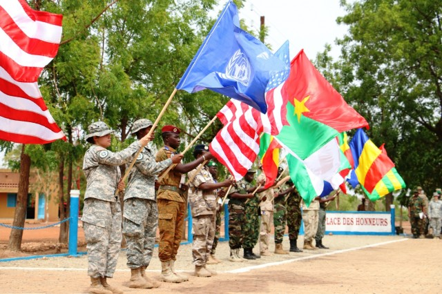 Multinational Western Accord 2016 participants display flags for each country represented at the exercise's Closing Day Ceremony May 13, 2016 at Camp Zagre, Ouagadougou, Burkina Faso. The two-week command post exercise, which began May 2, brought together 15 West African Nations, 7 NATO European countries and the U.S. to work as a multinational headquarters to build interoperability and shared understanding. (U.S. Army photo by Staff Sgt. Candace Mundt/Released)