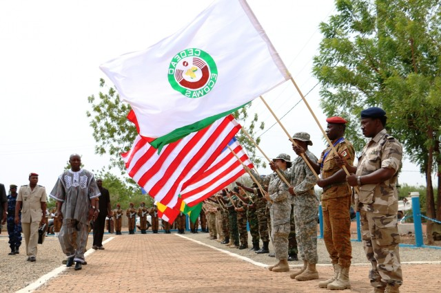 Burkina Faso Prime Minister Paul Kaba Thieba walks past the flags of multinational partners during the Western Accord 2016 Closing Day Ceremony May 13, 2016 at Camp Zagre, Ouagadougou, Burkina Faso. The two-week command post exercise, which began May 2, brought together 15 West African Nations, 7 NATO European countries and the U.S. to work as a multinational headquarters to build interoperability and shared understanding. (U.S. Army photo by Staff Sgt. Candace Mundt/Released)