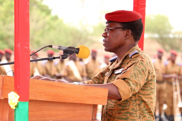 General Pingrenoma Zagre, Chief of Defense Staff for Burkina Faso Armed Forces, addresses dignitaries and multinational military leaders during the Western Accord 2016 Closing Day Ceremony May 13, 2016 at Camp Zagre, Ouagadougou, Burkina Faso. The two-week command post exercise, which began May 2, brought together 15 West African Nations, 7 NATO European countries and the U.S. to work as a multinational headquarters to build interoperability and shared understanding. (U.S. Army photo by Staff Sgt. Candace Mundt/Released)