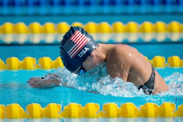 Army Staff Sgt. Elizabeth Marks swims for gold during the 2016 Invictus Games in Orlando, Fla., May 11, 2016. (DoD photo by EJ Hersom.)