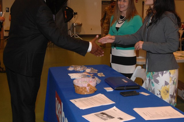 Chris Lewis discusses potential career options with Christine Edwards, right, and Lindsay Barnum, center, at the SFL — TAP Hiring Fair at Nutter Field House.