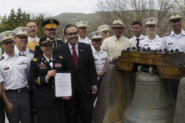 U.S. Army Garrison West Point Chaplain (Maj.) Valeria Van Dress, Philippine Counsel General Mario L. De Leon Jr., U.S. Military Academy at West Point Chief of Staff Col. Wayne Green, U.S. Military Academy at West Point Catholic Chaplain (Col.) Matthew Pawlikowski, Retired Counsel General Sonny Busa and U.S. Military Academy at West Point Cadets bid a final farewell to the San Pedro Bell before it is removed and shipped from the U.S. Military Academy at West Point Most Holy Trinity Catholic Chapel to the Church of Saints Peter and Paul in Bauang, La Union, Philippines, April 29 (U.S. Army photo by Thomas B. Hamilton III, USAG West Point Public Affairs/released.)