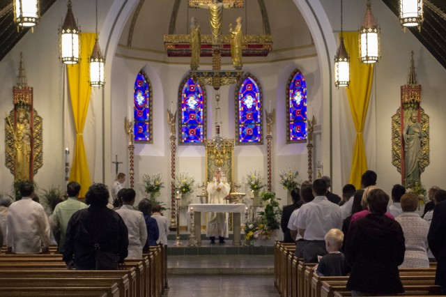 Chaplain (Col.) Matthew Pawlikowski celebrates mass with attendees of the valediction ceremony for the San Pedro Bell at the Most Holy Trinity Catholic Chapel at West Point (U.S. Army photo by Thomas B. Hamilton III, USAG West Point Public Affairs/released.)