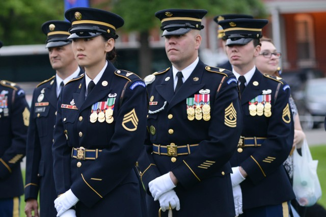 "Soldiers from the 3d U.S. Infantry Regiment (The Old Guard) stand at attention prior to the May 18, 2016 Twilight Tattoo performance at Summerall Field on Joint Base Myer-Henderson Hall. Twilight Tattoo is an hour-long historical show performed by Soldiers of the 3d U.S. Infantry Regiment (The Old Guard) and The U.S. Army Band ""Pershing's Own."""