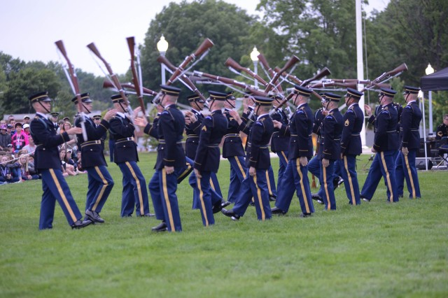 "Soldiers from the U.S. Army Drill Team, 3d U.S. Infantry Regiment (The Old Guard) perform during the May 18, 2016 Twilight Tattoo at Summerall Field on Joint Base Myer-Henderson Hall. Twilight Tattoo is an hour-long historical show performed by Soldiers of the 3d U.S. Infantry Regiment (The Old Guard) and The U.S. Army Band ""Pershing's Own."""