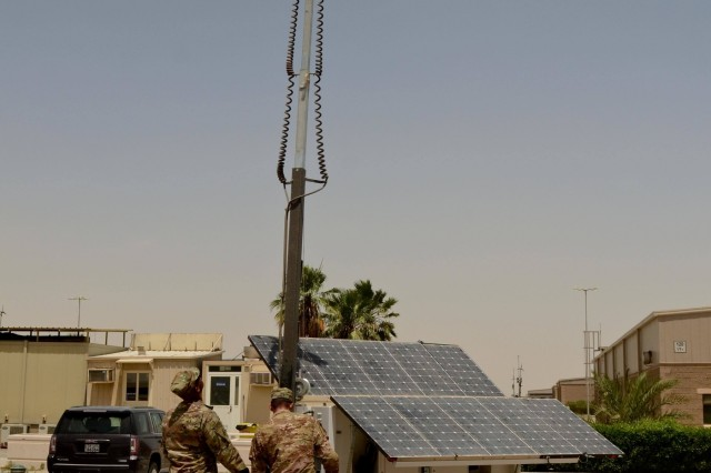 Chief Warrant Officer 3 Weaver Prosper (Left), the U.S. Army Central operational energy program manager, and Staff Sgt. Adam Isdale, the noncommissioned officer in charge of the USARCENT forward engineers, inspect a solar powered light system on Camp Arifjan, Kuwait, May 16, 2016.