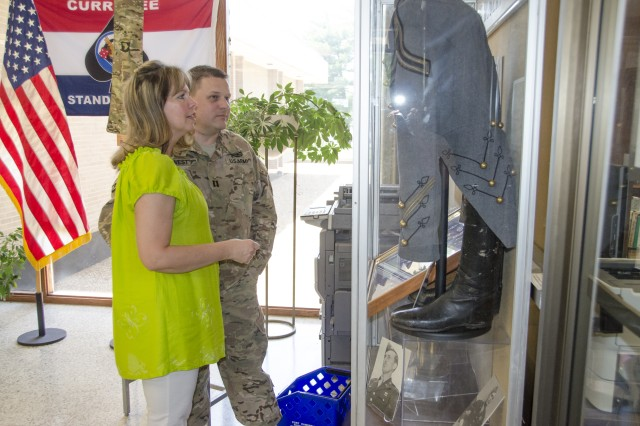 Chap. (Capt.) Paul West, Warrior Transition Battalion, and his wife Judy, admire the exhibit of Lt. Gen. Robert F. Sink artifacts and memorabilia displayed in the Robert F. Sink Memorial Library foyer. Many artifacts were donated by Sink's Family.