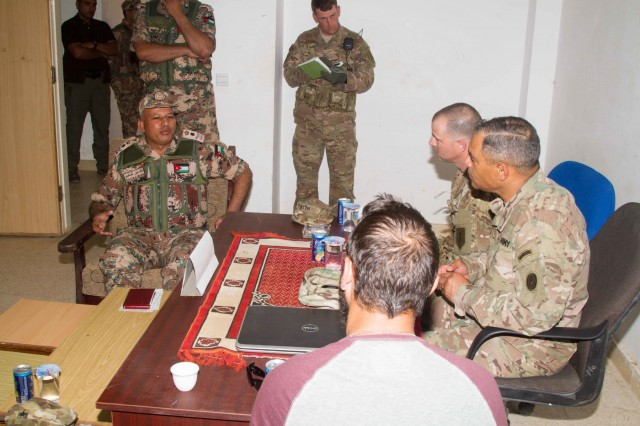Jordan Army Lt. Col. Khaled M. Al-Mnaseer (left), the commander of the 6th King Ghazi Mechanized Infantry Battalion, briefs U.S. Army Lt. Gen. Michael X. Garrett (right), the commanding general of U.S. Army Central, about the partnership capabilities the Jordanian and U.S. forces have achieved over the past weeks at the Jordanian Training Center, Jordan, April 20. The USARCENT command team met with leaders of partner militaries throughout USARCENT's area of responsibility to continue to build bilateral partnership ties. (U.S. Army photo by Sgt. David N. Beckstrom, 19th Public Affairs Detachment, U.S. Army Central)