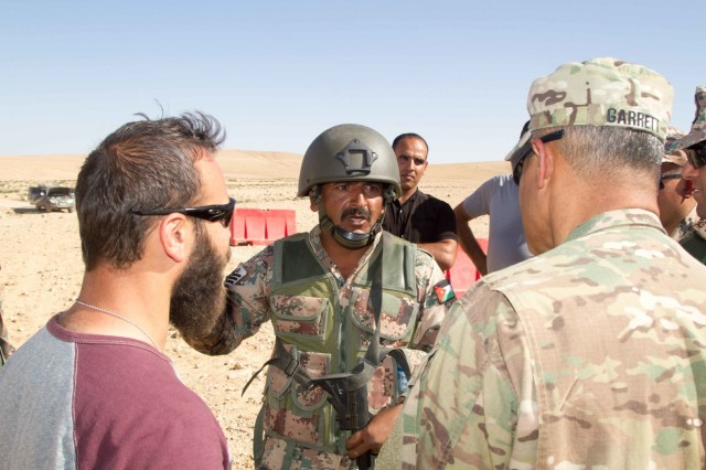 Jordan Army 1st Sgt. Za'l Khalaf (center), a soldier with 6th King Ghazi Mechanized Infantry Battalion, discusses the role of noncommissioned officers in the Jordanian military with Lt. Gen. Michael X. Garrett (right), the commanding general of U.S. Army Central, at the Jordanian Training Center, Jordan, April 20, 2016. The USARCENT command team met with leaders of partner militaries throughout USARCENT's area of responsibility to continue to build bilateral partnership ties. (U.S. Army photo by Sgt. David N. Beckstrom, 19th Public Affairs Detachment, U.S. Army Central)