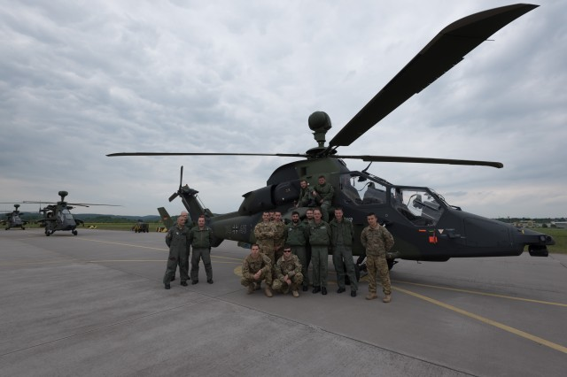 "Pilots from Kampfhubschrauberregiment 36 ""Kurhessen,"" and from 1st Battalion, 3rd Aviation Regiment, 12th Combat Aviation Brigade pose in front of a Tiger Attack Helicopter during exercise Strong Punch on Fritzlar Air base near Fritzlar, Germany, May 19, 2016.  Strong Punch is an exercise laboratory in which German and American aviators can evaluate and refine the effectiveness of their current tactics, techniques and procedures (TTP's) in a threat environment that consists of real world, modern electronic warfare platforms (EW) and reconnaissance surveillance equipment."
