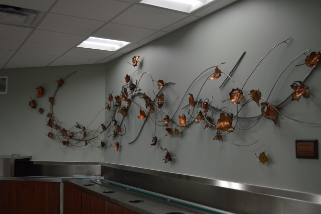 """""""Wind Song,"""" a sculpture created by a wounded warrior and former patient, adorns the wall of Brooke Army Medical Center's dining room."""