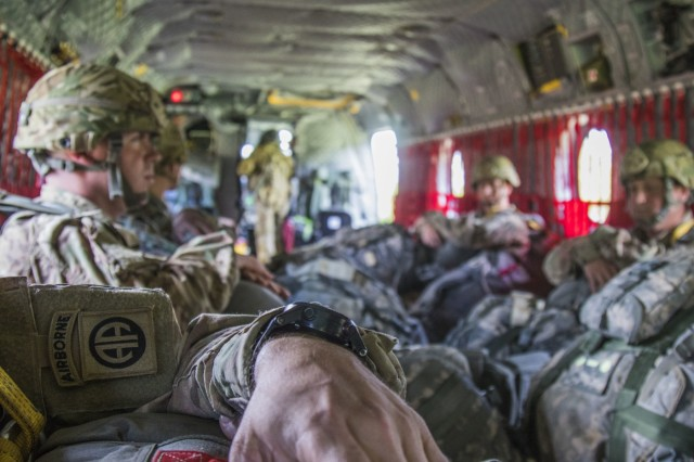 The 82nd Airborne Division patch sits on the left shoulder of a paratrooper prior to exit from a CH-47 Chinook from the 82nd Combat Aviation Brigade during the Little Group of Paratroopers event of All American Week 2016,Fort Bragg, N.C. May 23. The LGOP event tested the paratroopers on their essential task list with events such as rigging their equipment, readying their equipment for service, and a layout of all required equipment. (U.S. Army photo by Staff Sgt. Christopher Freeman/ 82nd CAB PAO)