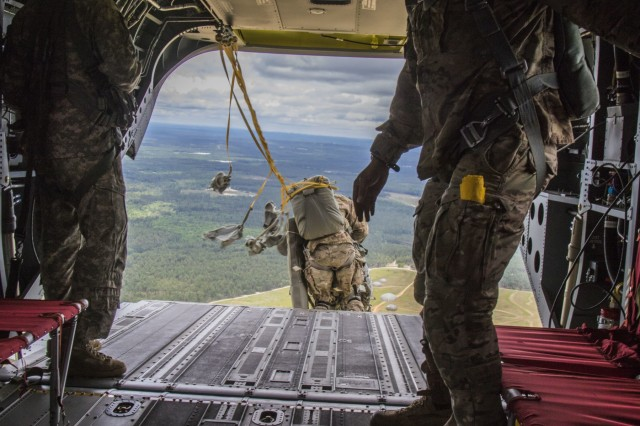 A jumper from the 82nd Airborne Division exits a CH-47 Chinook from the 82nd Combat Aviation Brigade during the Little Group of Paratroopers event of All American Week 2016,Fort Bragg, N.C. May 23. The LGOP event tested the paratroopers on their essential task list with events such as rigging their equipment, readying their equipment for service, and a layout of all required equipment. (U.S. Army photo by Staff Sgt. Christopher Freeman/ 82nd CAB PAO)