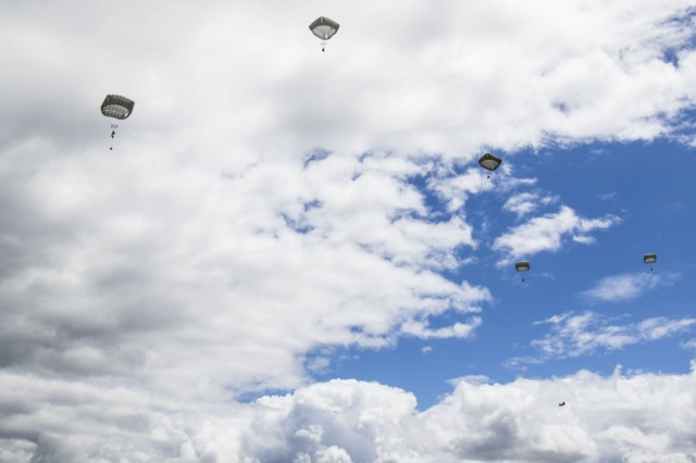 Paratroopers from the 82nd Airborne Division exit a CH-47 Chinook during the Little Group of Paratroopers event of All American Week 2016,Fort Bragg, N.C. May 23. The LGOP event tested the paratroopers on their essential task list with events such as rigging their equipment, readying their equipment for service, and a layout of all required equipment. (U.S. Army photo by Staff Sgt. Christopher Freeman/ 82nd CAB PAO)