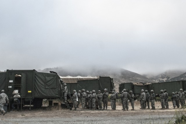 As the sun tries to make its way over the horizon, a long line of hungry soldiers gathers in search of a hot meal during the 224th Sustainment Brigade's 2016 annual training event at Camp Roberts, May 17. Food service specialists from the unit's headquarters element will spend three hours in preparation of both breakfast and dinner in order to feed the hungry California Army National Guard troops every day. (U.S. Army Photo by Staff Sgt. Melissa Wood/RELEASED)