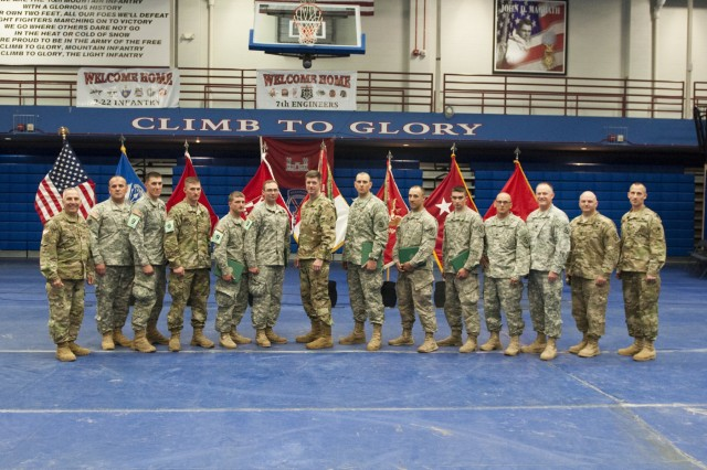 Army Soldiers from Company A, Special Troops Battalion, 86th Infantry Brigade Combat Team (Mountain), Vermont National Guard, Spc. Michael T. Babbin, Sgt. Sawyer D. Batten, assistant team leader, Private 2 Austin J. Demasisayers, Spc. Jody A. Fabian, Staff Sgt. Randy S. Hook, team leader, Spc. Jason W. Knight, Spc. Mathew P. Latour, Spc. Calvin J. Miller, are recognized for placing second in the 2016 Sapper Stakes competition at Fort Drum, New York, during the third year of the competition.