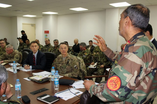 "The author, center left, and MG Gordon B. ""Skip"" Davis Jr., CSTC-A commanding general, listen as Afghan First Deputy Minister of Defense Gen. Abdul Khaliq talks to ANA logisticians on sustainment goals in advance of the spring and summer campaigns, at a two-day materiel readiness seminar in February. (U.S. military photo by LT Charity A. Edgar, CSTC-A Public Affairs)"