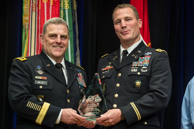 Chief of Staff of the U.S. Army Gen. Mark A. Milley, left, recognized U.S. Army Garrison, Fort Wainwright, Alaska, as a bronze winner for installation excellence, during the 2016 Army Communities of Excellence Awards ceremony, May 24, 2016, in the Pentagon. Col. Sean C. Williams accepted the award.