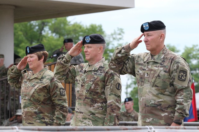 (From left) Maj. Gen. Peggy Combs, outgoing commander, Lt. Gen. Kevin W. Mangum, Deputy Commanding General/Chief of Staff, U.S. Army Training and Doctrine Command, and Maj. Gen. Christopher Hughes, incoming commander of Cadet Command and Fort Knox, salute as the national anthem is played during the change of command ceremony at Fort Knox May 25.