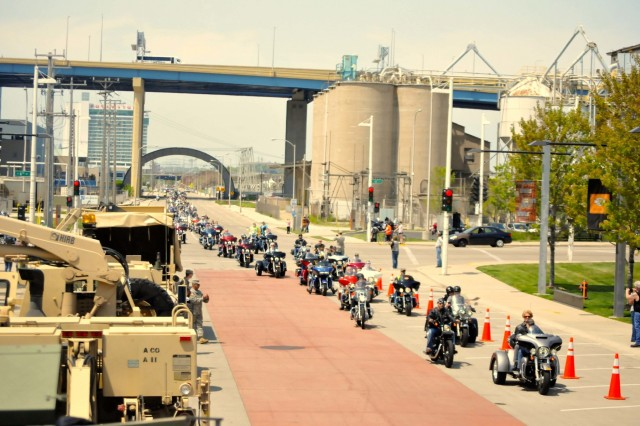 Motorcycles line up on Milwaukee's lake front near Army vehicles to take part in the nearly 500 cycle 13th Annual Support the Troops Ride May 21. (Photo by Spc. Brianna Saville)