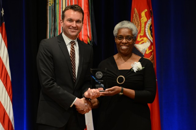 During the 2016 Secretary of the Army Awards ceremony, May 25, 2016, in the Pentagon, Secretary of the Army Eric K. Fanning recognized Patricia M. Radcliffe, writer and editor, Air Land Sea Application Center, JBLM, with the Secretary of the Army Award for Publications Improvements (Command).