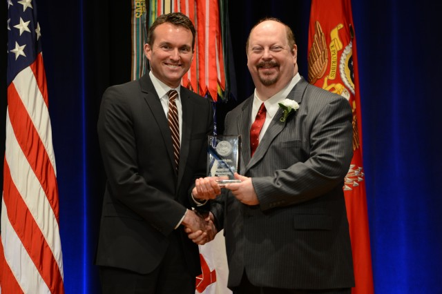 During the 2016 Secretary of the Army Awards ceremony, May 25, 2016, in the Pentagon, Secretary of the Army Eric K. Fanning recognized Gregory J. Orme, chief, Media Production Division, U.S. Army John F Kennedy Special Warfare Center and School, U.S. Army Special Operations Command, Fort Bragg, North Carolina, with the Secretary of the Army Award for Publications Improvements (Departmental).