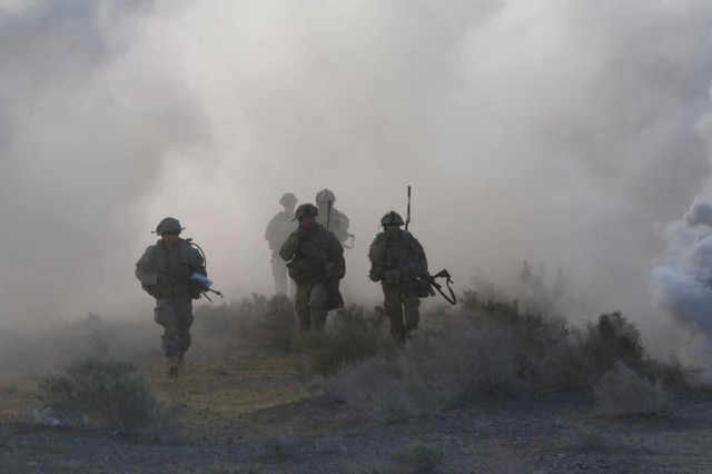 Soldiers assigned to 1st Battalion (attached to 1-2 Stryker Brigade Combat Team for training), 28th Infantry Regiment, 3rd Infantry Division, move under the cover of smoke during Decisive Action Rotation 16-06 at the National Training Center in Fort Irwin, Calif., May 16, 2016. The training focused on the 1-2 SBCT combating a near-peer enemy and smaller militant groups in a foreign country.