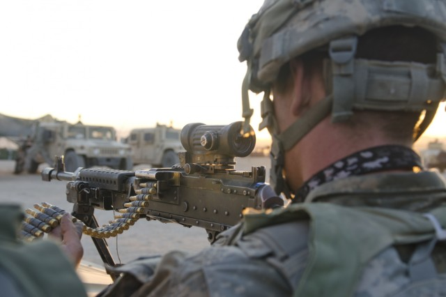 A Soldier assigned to 1-2 Stryker Brigade Combat Team prepares to fire back at enemy soldiers during Decisive Action Training Rotation 16-06 at the National Training Center in Fort Irwin, Calif., May 16, 2016. The training focused on the 1-2 SBCT combating a near-peer enemy and smaller militant groups in a foreign country.