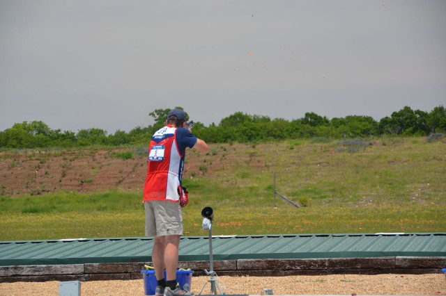 TILLAR, Ark.—Sgt. 1st Class Josh Richmond, U.S. Army Marksmanship Unit (USAMU), fires at one of the hundreds of clays he needed to hit to earn the final double trap seat on the U.S. Olympic Shooting Team during the 2016 Shotgun Olympic Trials Part II in Tillar, Arkansas, May 19, 2016. Richmond will join two other USAMU Soldiers at the 2016 Olympic Games in Rio de Janeiro in August.  (U.S. Army photo by Brenda Rolin/released)