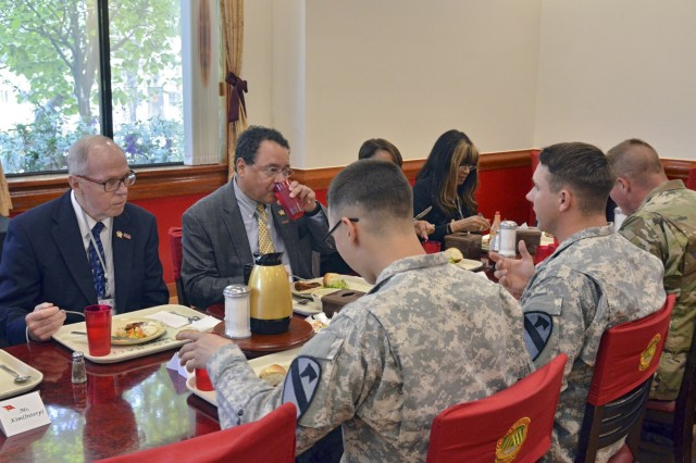 Southfield, Michigan, Mayor Kenson Siver and Southfield City Councilman Daniel Brightwell, share experiences with Spc. Nathan Hurd (left) and Sgt. Kyle Mexicotte (right) from 2nd Battalion, 12th Cavalry Regiment, 1st Armored Brigade Combat Team, 1st Cavalry Division, during a luncheon at the Thunder Inn Dining Facility, May 4. (U.S. Army photo by Pfc. Dasol Choi, 1st Armored Brigade Combat Team Public Affairs, 1st Cav. Div.)