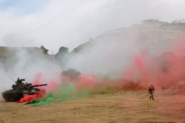 A Turksih tank and soldier move a simulated objective during a combined Air and Amphibious Assault, which was part of Exercise EFES 2016, May 24. EFES is Turkey's largest military exercise, which was held as a multinational event for the first time this year, including about 7,000 miltiary members from nine different countries.