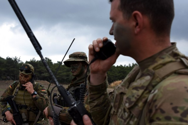 (Right to left) U.S. Army Sgt. 1st Class Zachery Rieck, a platoon sergeant with A Company, 54th Brigade Engineer Battalion, of the 173rd Infantry Brigade Combat Team (Airborne) and German Army Cpl. Marco W., a radio operator with 2nd Company, 31st Airborne Regiment, do a communication check during a multinational Air Assault exercise May 22. They were two of 7,000 multinational Soldiers participating in Exercise Efes 16, a Turkish-led multi-national exercise that includes service members from 9 different countries.