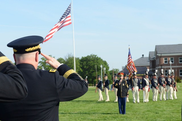 "Gen. Mark A. Milley, chief of staff of the U.S. Army, salutes during the singing of the National Anthem at Twilight Tattoo on Joint Base Myer-Henderson Hall May 25, 2016. Milley presented Robert Irvine, founder of the Robert Irvine Foundation, and Kathy-Roth Douquet, chief executive officer and president of Blue Star Families, with the Army Outstanding Civilian Service Award during the special ""Salute from the Chief"" Twilight Tattoo.  Twilight Tattoo is an hour-long historical show performed by Soldiers of the 3d U.S. Infantry Regiment (The Old Guard) and The U.S. Army Band ""Pershing's Own."""