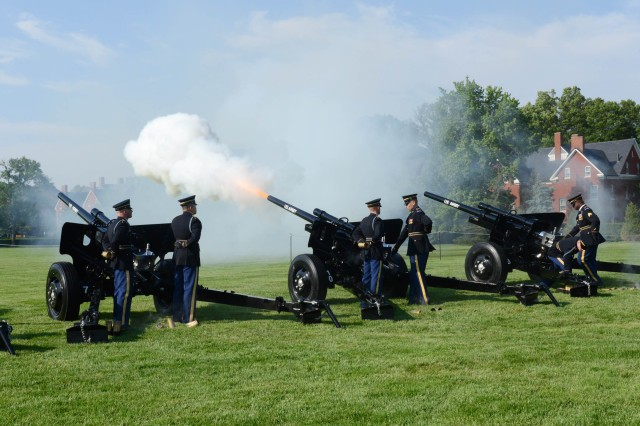 "Soldiers from the Presidential Salute Battery, 3d U.S. Infantry Regiment (The Old Guard) fire a cannon salute to U.S. Army Chief of Staff Gen. Mark Milley during the May 25, 2016, Twilight Tattoo at Summerall Field on Joint Base Myer-Henderson Hall. Milley presented Robert Irvine, founder of the Robert Irvine Foundation, and Kathy-Roth Douquet, chief executive officer and president of Blue Star Families, with the Army Outstanding Civilian Service Award during the special ""Salute from the Chief"" Twilight Tattoo.  Twilight Tattoo is an hour-long historical show performed by Soldiers of the 3d U.S. Infantry Regiment (The Old Guard) and The U.S. Army Band ""Pershing's Own."""