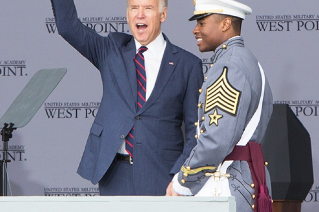 Vice President Joe Biden, guest speaker at the U.S. Military Academy at West Point Class of 2016 Graduation, receives a Tarbucket Bust from First Captain and Class President Cadet E.J. Coleman (U.S. Army photo by Michelle Eberhart, USMA West Point Public Affairs/released.)
