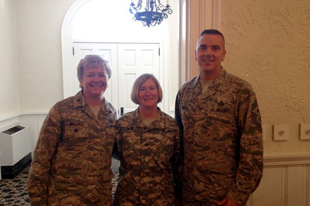 (left) Air Force Col. Ginger Wallace, Col. Janet Holliday and Air Force Chief Master Sgt. John Thompson, Wallace's senior enlisted advisor at the Defense Language Institute in Monterey, California, where she was the assistant commandant from 2013 to 2015 at Fort Knox July 2015 at Holliday's change of command.