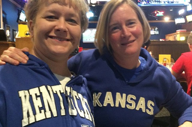 Left, Air Force Col. Ginger Wallace is a Kentucky fan, but Col. Janet Holliday is a Kansas fan.