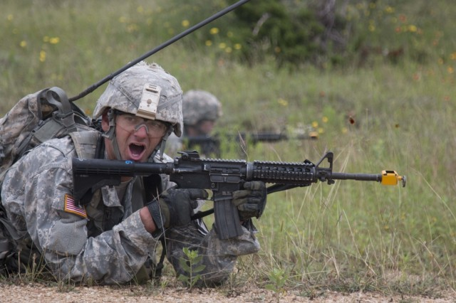 Sgt. Michael Catherman, a combat engineer assigned with Company B, 3rd Engineer Battalion, 3rd Armored Brigade Combat Team, 1st Cavalry Division, shouts orders to his team members during a react to contact scenario during the company's engineer qualification tables. Along with basic engineer tasks, the Soldiers were expected to complete basic Soldier tasks, including evaluating casualties. (U.S. Army photo by Staff Sgt. Leah R. Kilpatrick, 3rd Armored Brigade Combat Team Public Affairs Office (released)