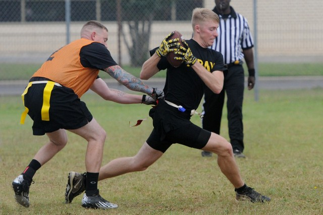Spc. Timothy Kachelmuss, a Stryker maintainer with Renegade Troop, 4th Squadron, 3rd Cavalry Regiment, catches a pass May 16 during the Brave Rifles Week flag football tournament at Fort Hood, Texas. Brave Rifles Week is a celebration of the regiment's birthday. (Photo by Spc. Erik Warren, 3rd Cavalry Regiment Public Affairs)