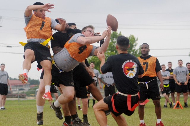 Troopers of 1st Squadron, and 4th Squadron, play in the Brave Rifles Week flag football tournament May 16 at Fort Hood, Texas. (Photo by Spc. Erik Warren, 3rd Cavalry Regiment Public Affairs)
