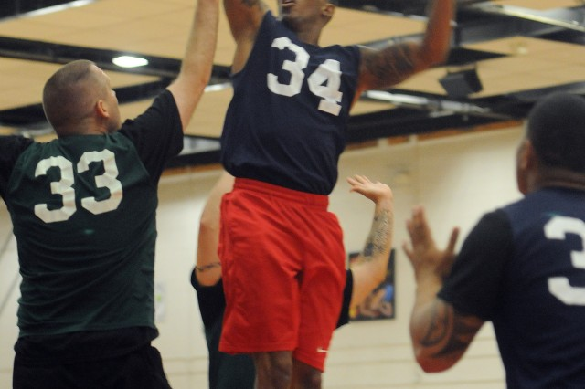 Spc. Darius Threadgill, an infantrymen in Heavy Troop, 3rd Squadron, 3rd Cavalry Regiment, scores in a basketball game against 2nd Squadron during the Brave Rifles Week basketball tournament at Fort Hood, Texas. (Photo by Spc. Erik Warren, 3rd Cavalry Regiment Public Affairs)